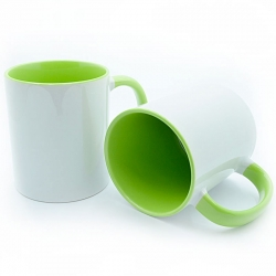 Cup with a light green handle and the inside